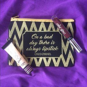 New makeup bag w/ 2 Victoria Secret glosses